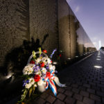 Vietnam Veteran's Memorial with Bouquet and Washington Monument